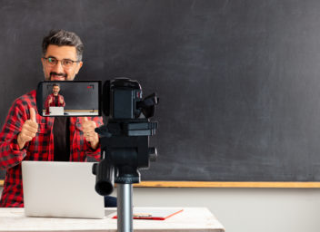 Adult man teacher is filming movie for online education.